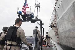 Sailors aboard USS Coronado participate in visit, board, search and seizure training.