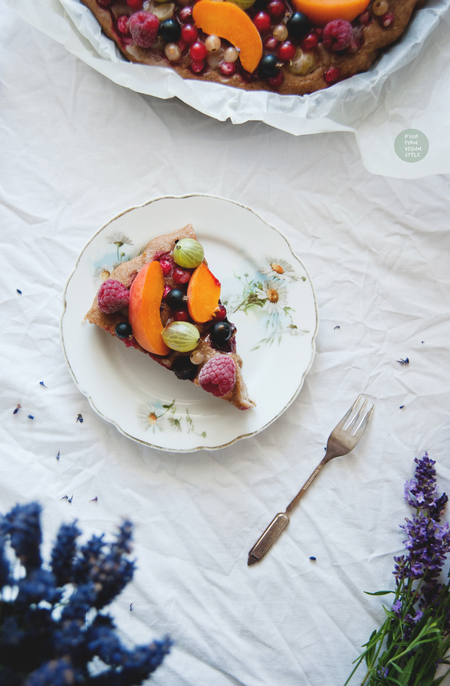 Vegan yoghurt cake with summer fruits and lavender icing