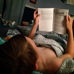 Laying in bed with my kid while he reads his book #lovemyboy #hankzipzer