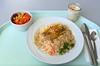 Hake with sesame on herb sauce & rice / Seehecht in Sesamkruste mit Kräutersauce auf Gemüsereis