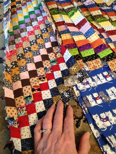 I set in the start of a 3rd row of cats in the scrappy Bargello. I stopped at JoAnn's yesterday and found the blue cat fabric to the right that is the perfect scale for this project.