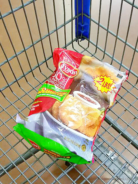A bag of Tyson Chicken Nuggets in a shopping cart.