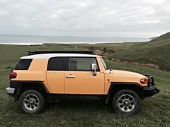 hummer h3t(0.0), automobile(1.0), automotive exterior(1.0), sport utility vehicle(1.0), wheel(1.0), vehicle(1.0), toyota fj cruiser(1.0), compact sport utility vehicle(1.0), compact car(1.0), bumper(1.0), land vehicle(1.0), luxury vehicle(1.0),