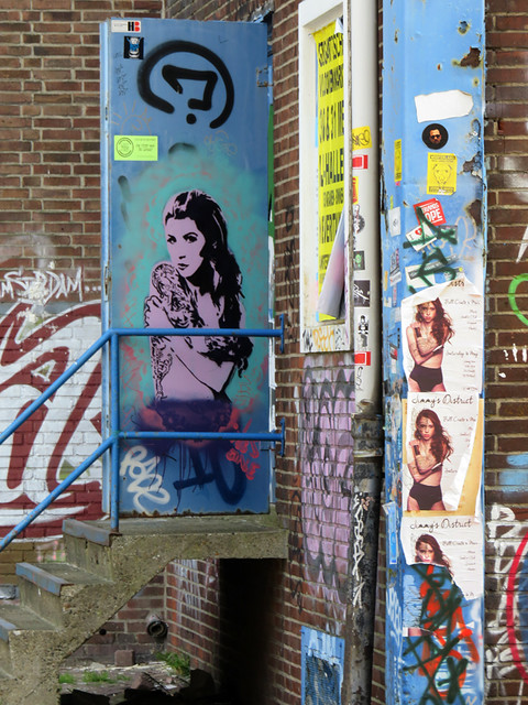 Brightly-coloured shipping containers provide living space and studios for artists in NDSM, an industrial area across the river from Amsterdam