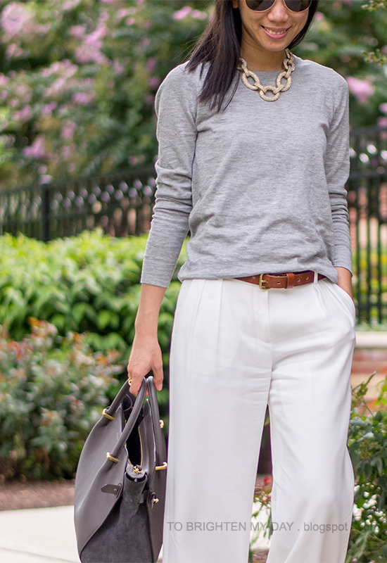 statement chain necklace, gray sweater, white pants