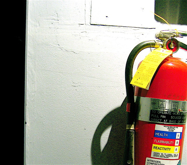 fire extinguisher Legible nameplate and operation instructions facing outward