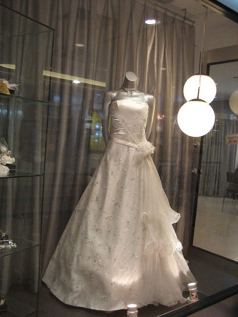 b7d15e4dec16 White wedding gown with frills at one side at a shop somewhere near Billy