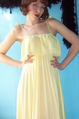bridal clothing(0.0), abdomen(0.0), sleeve(0.0), peach(0.0), formal wear(0.0), human body(0.0), wedding dress(0.0), bridesmaid(0.0), prom(0.0), bridal party dress(1.0), neck(1.0), textile(1.0), clothing(1.0), yellow(1.0), aqua(1.0), photo shoot(1.0), dress(1.0),