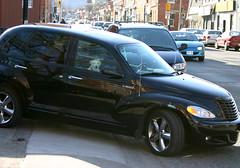 minivan(0.0), automobile(1.0), automotive exterior(1.0), executive car(1.0), wheel(1.0), vehicle(1.0), automotive design(1.0), chrysler pt cruiser(1.0), rim(1.0), city car(1.0), chrysler(1.0), sedan(1.0), land vehicle(1.0), luxury vehicle(1.0), motor vehicle(1.0),