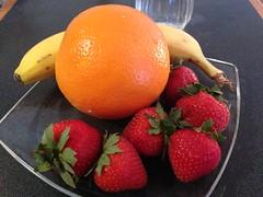 Strawberries, banana, orange