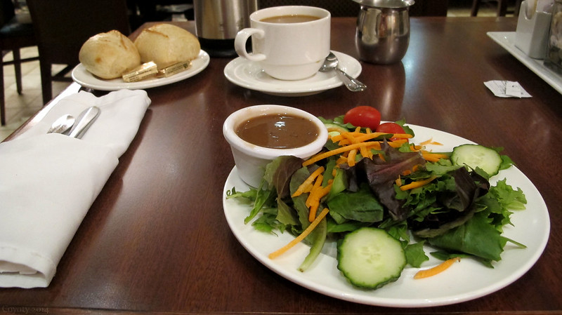 Salad with balsamic dressing, rolls, and coffee