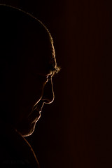 Profile head of a buddhist monk in backlit conditions