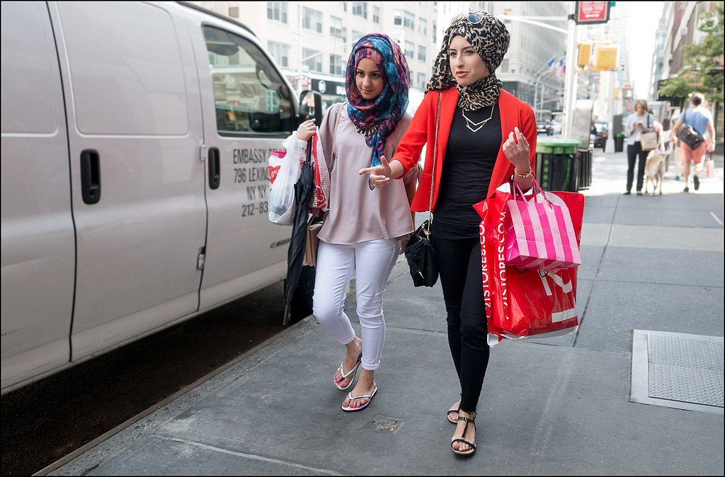 SS7-15 3w red jacket over black pants and top leopard print and mulit color hijab