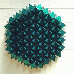 art paper(0.0), aqua(0.0), jewellery(0.0), origami paper(0.0), circle(0.0), art(1.0), pattern(1.0), symmetry(1.0), origami(1.0), triangle(1.0), turquoise(1.0), teal(1.0), green(1.0), design(1.0),