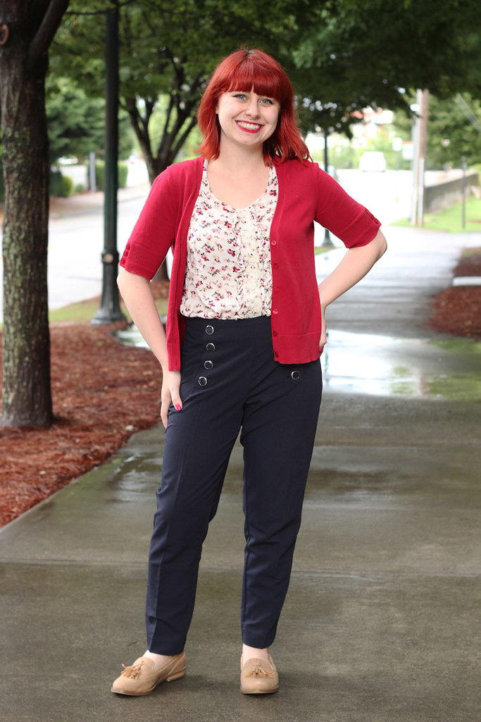 Navy Blue Skinny Sailor Trousers, Tan Loafers, Floral Print Shirt, and Red Cardigan