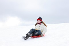 snowboarding(0.0), vehicle(0.0), snowboard(0.0), winter sport(1.0), footwear(1.0), winter(1.0), sports(1.0), snow(1.0), sports equipment(1.0), extreme sport(1.0), sledding(1.0), sled(1.0),
