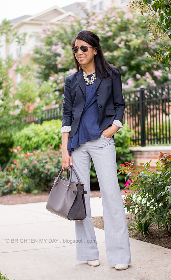 pearl statement necklace, navy blazer, navy top, gray pants, gray tote bag