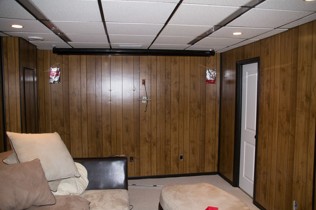 Wood paneled walls in basement