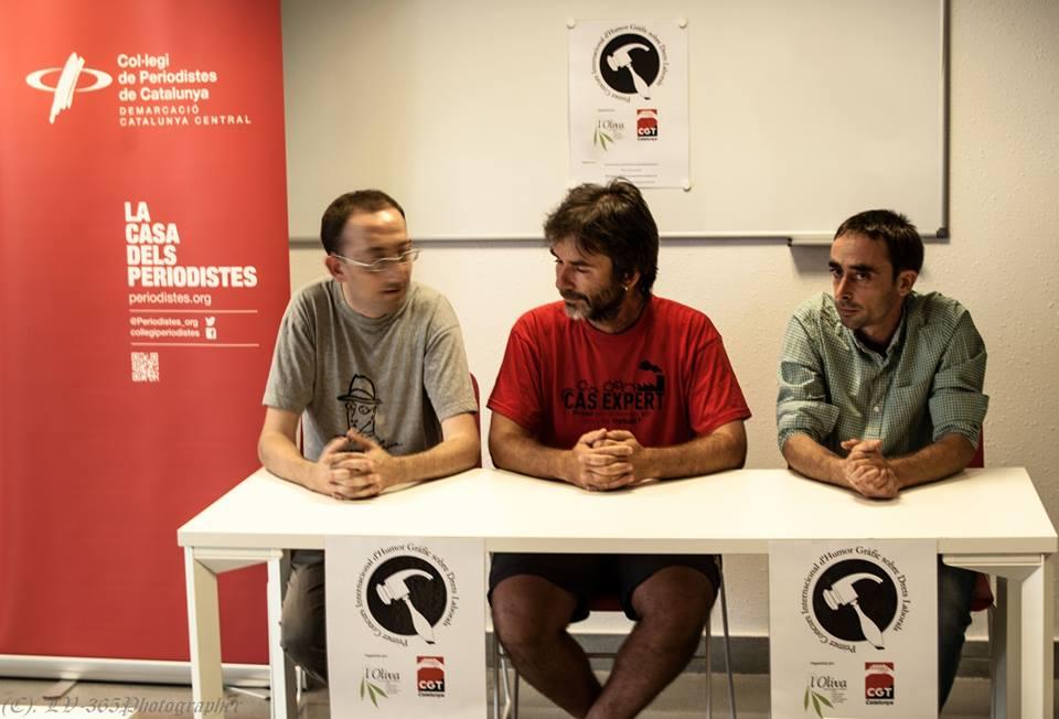 Imatge de la presentació del Concurs d´Humor Gràfic en Drets Laborals a Manresa, amb Ermengol Gassiot, Francesc Sol i Moisès Rial