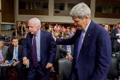 U.S. Secretary of State John Kerry says goodbye to U.S. Senator John McCain on July 29, 2015, after he came over to greet him before the Secretary joined U.S. Defense Secretary Ash Carter, Joint Chiefs of Staff Chairman Martin Dempsey, U.S. Energy Secretary Dr. Ernest Moniz, and U.S. Treasury Secretary Jack Lew in testifying about the Iranian nuclear deal before the Senate Armed Services Committee in Washington, D.C. [State Department photo/ Public Domain]