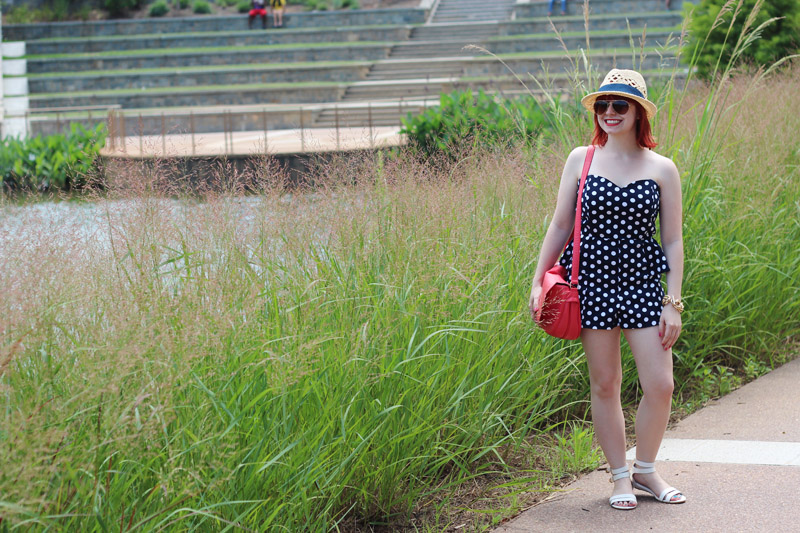 Navy Blue Sweetheart Neckline Playsuit with White Sandals and a Straw Hat