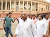 Samajwadi Party leader Mulayam Singh Yadav with party MPs coming out of Parliament House in New Delhi on Tuesday. by legend_news