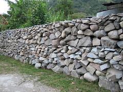 asphalt(0.0), soil(0.0), flagstone(0.0), bedrock(0.0), walkway(0.0), flooring(0.0), boulder(1.0), stone wall(1.0), wall(1.0), rubble(1.0), cobblestone(1.0), landscaping(1.0), rock(1.0),
