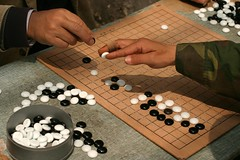 chessboard(0.0), english draughts(0.0), carom billiards(0.0), chess(0.0), go(1.0), indoor games and sports(1.0), play(1.0), sports(1.0), recreation(1.0), tabletop game(1.0), games(1.0), board game(1.0),
