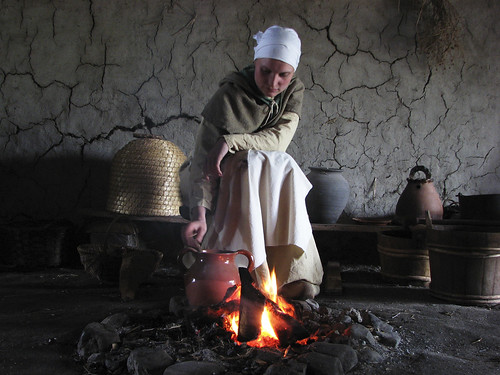 medieval woman next to fire