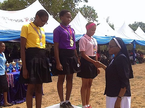 Catherine Ologunagba SSL presents the medals to the winners of the 2015 Sports Competition at Louisville Girls Secondary School, Abuja