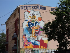 billboard(0.0), art(1.0), street art(1.0), mural(1.0), urban area(1.0), neighbourhood(1.0), advertising(1.0),
