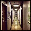 Reasons why I :heart:️ my office: this perfect 20th century hallway. #utilitarian #gothic #flicker