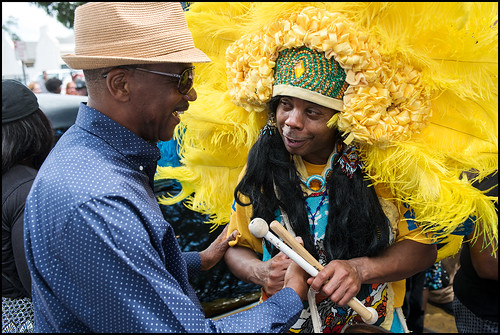 Yellow Pocahontas Big Chief Darryl Montana and Spy Boy Honey say hello during the funeral second line in honor of Big Queen Mercedes