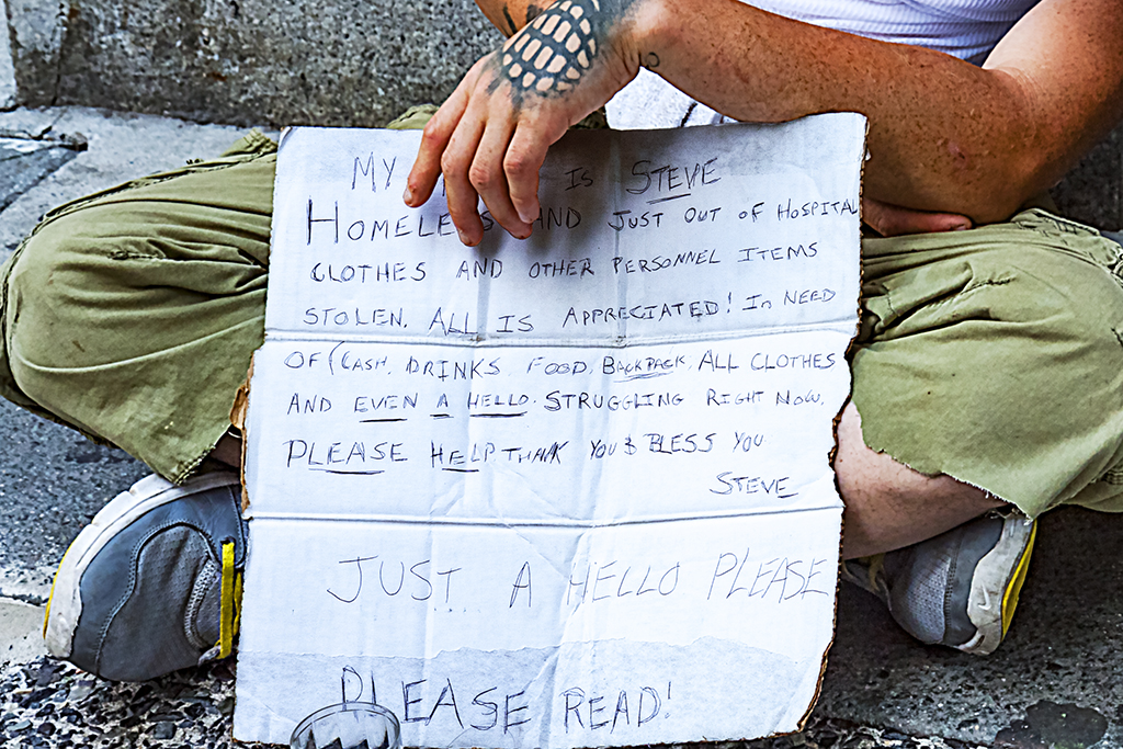 Homeless man and US flag set--Center City (detail)
