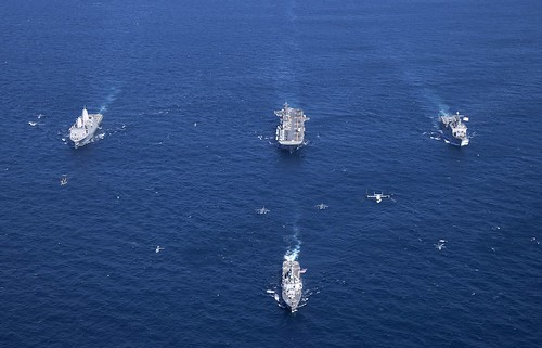 INDIAN OCEAN – The USS Bonhomme Richard (LHD 6) [center], USS Ashland (LSD 48) [right], USS Green Bay (LPD 20) [left], and USS Preble (DDG 88 ) [front] move in formation off the western coast of Australian.