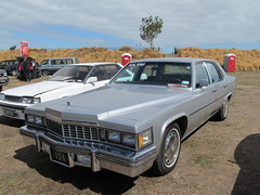 performance car(0.0), automobile(1.0), automotive exterior(1.0), cadillac(1.0), vehicle(1.0), cadillac brougham(1.0), cadillac calais(1.0), full-size car(1.0), cadillac coupe de ville(1.0), sedan(1.0), classic car(1.0), land vehicle(1.0), luxury vehicle(1.0),