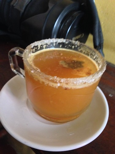 Canelazo, hot drink made from aguadiente, sugar cane water and spices with a sugar rim