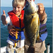 Out-fished by a kid by Earl Reinink