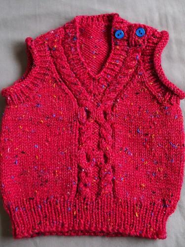 red baby vest