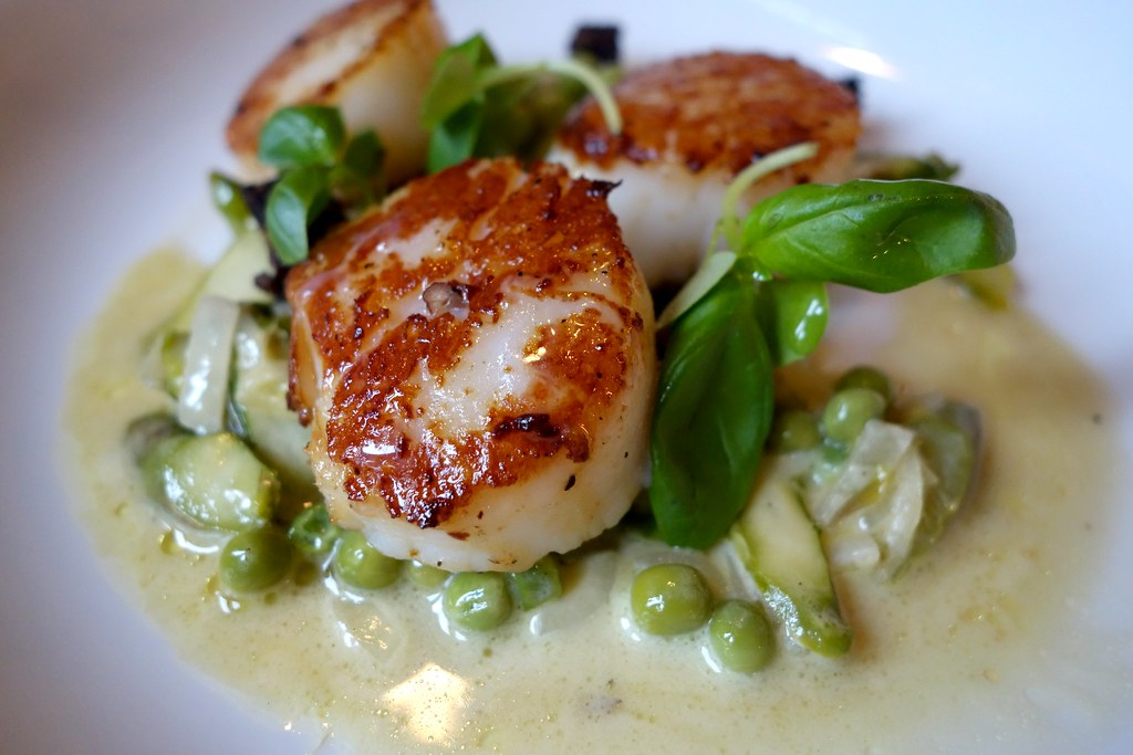 Russell's Restaurant - Seared King Scallops, Pea & Asparagus Compote,  Diced Black Pudding, drizzled with Black Truffle Oil