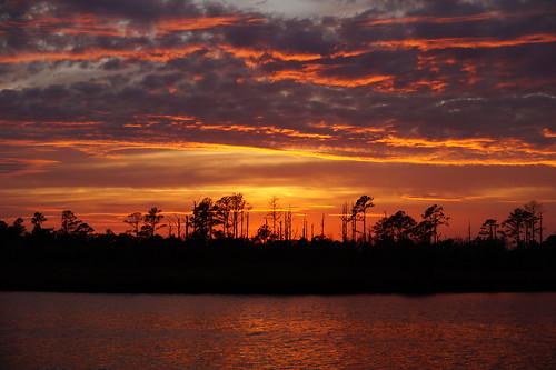 cloudsstormssunsetssunrises spectacularsunsetsandsunrises sunset creek northwestcreek northcarolina cloudscape clouds red orange sony sonya58 sonyphotographing