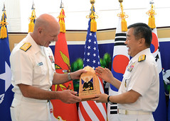 Adm. Scott H. Swift, commander of U.S. Pacific Fleet, is presented a gift by Adm. Jung, Ho-sub, the Republic of Korea's chief of naval operations. (U.S. Navy/Lt.j.g. Joshua Kelsey)