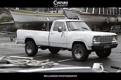 chevrolet(0.0), dodge ramcharger(0.0), automobile(1.0), automotive exterior(1.0), pickup truck(1.0), vehicle(1.0), truck(1.0), bumper(1.0), land vehicle(1.0), motor vehicle(1.0),