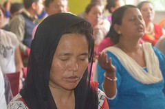 Nepali Christian woman praying for the rights to be heard in new Constitution