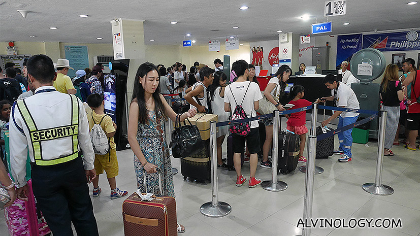 The snaking queues for the other airlines' check-in counters