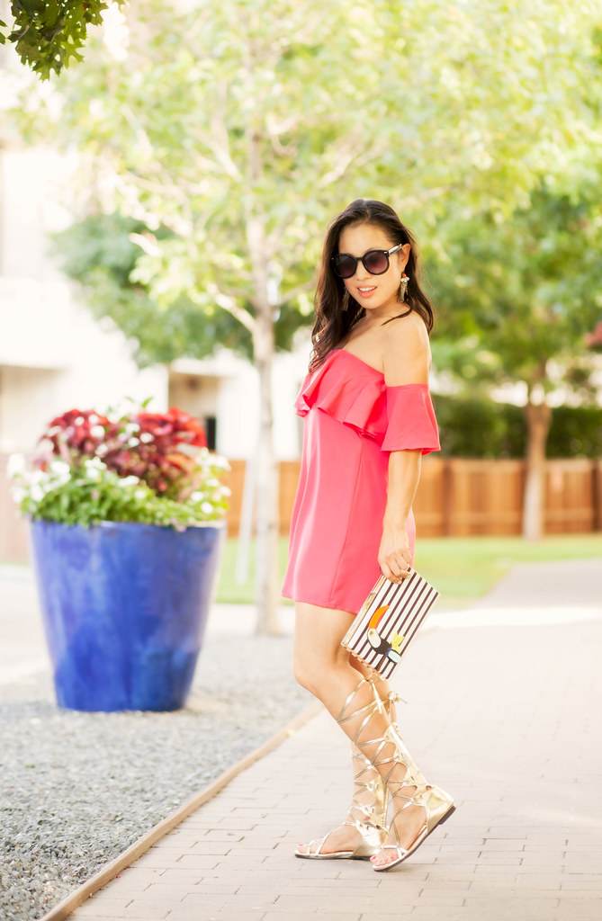 cute & little blog | petite fashion | pink off-shoulder ruffle dress, kate spade toucan striped clutch, gold strappy gladiator sandals, baublebar statement earrings | spring summer outfit