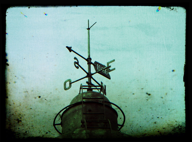 A weather vane tops a Spanish lighthouse on the Costa Verde of Sp