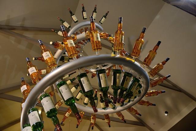 215-20160726_The Glenlivet Distillery-Banffshire-Visitor Centre-display of malt whisky bottles-detail
