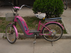 sports equipment(0.0), hybrid bicycle(0.0), racing bicycle(0.0), tricycle(0.0), moped(1.0), wheel(1.0), vehicle(1.0), land vehicle(1.0), bicycle(1.0),