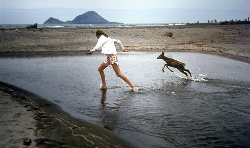 Girl With Fawn.Taken at Thornton Beach, near Whakatane BOP by sirwiseowl